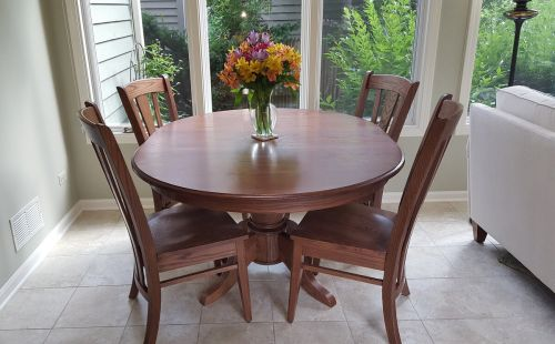 Expandable Pedestal Table Paired with Modern Chairs