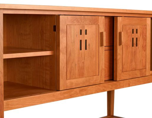Eastwood Sideboard has adjustable shelves behind sliding doors