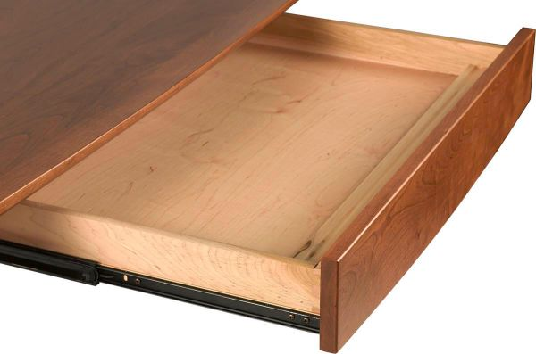 Desk drawer functions as a keyboard tray or pencil drawer.